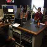 View of the radio studio with host Rick Hamada