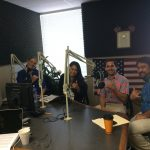 The radio show guests sitting in the studio.