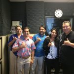 Host Rick Hamada and his radio show guests.